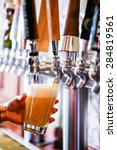 bartender pouring draft beer in ... | Shutterstock . vector #284819561