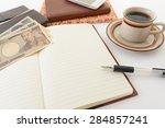notebook and bills   Shutterstock . vector #284857241