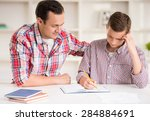 happy father helping his son to ... | Shutterstock . vector #284884691