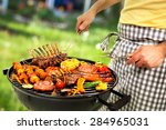 man is grilling meat on... | Shutterstock . vector #284965031