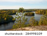 Stock photo pine tree on a background of autumn lake landscape 284998109