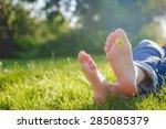 Bare Feet On Spring Grass
