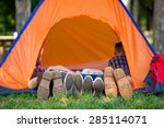 Four People Lying In A Tent...