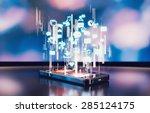 black smartphone emitting... | Shutterstock . vector #285124175