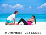 young fitness couple doing side ... | Shutterstock . vector #285133319