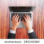 man hands on a laptop keyboard  | Shutterstock . vector #285140384