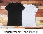 blank t shirts on a wooden... | Shutterstock . vector #285140741