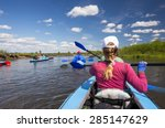 young people are kayaking on a... | Shutterstock . vector #285147629