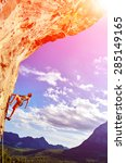 female rock climber climbs on a ... | Shutterstock . vector #285149165