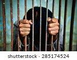 Man Behind Jail Bars Reaching...