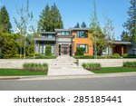 modern house with wood trim... | Shutterstock . vector #285185441