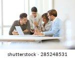 Business People Meeting Around...