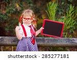 happy little schoolgirl with...   Shutterstock . vector #285277181