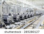 Production line for manufacturing of the engines in the car factory. Car factory. Car parts. Engine factory. New engine factory. Engines on line.