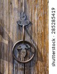 old door handle on wooden door | Shutterstock . vector #285285419