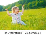 girl sitting on the grass and...   Shutterstock . vector #285290117