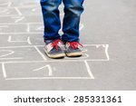 little boy playing hopscotch on ... | Shutterstock . vector #285331361