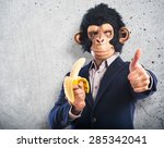 Monkey Man Eating A Banana Ove...
