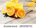orange juice on table close up | Shutterstock . vector #285358751