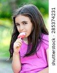 friendly little girl enjoying a ... | Shutterstock . vector #285374231