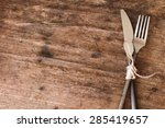 Old Fork And Knife Tied With A...