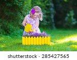 Child Working In The Garden....