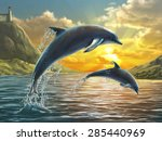 Two Dolphins Jumping Out Of Se...