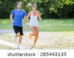 young people jogging and... | Shutterstock . vector #285443135