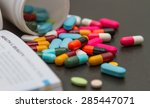 many pills and tablets on black