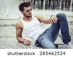sexy model in aviator sunglasses | Shutterstock . vector #285462524
