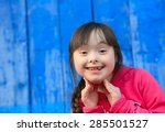 Young Girl Smiling On...