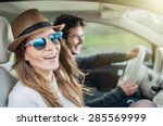 young couple in his car  happy... | Shutterstock . vector #285569999