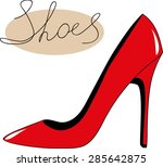 Red High Heeled Shoe Over Whit...