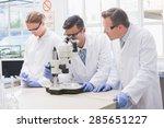 scientists examining something... | Shutterstock . vector #285651227