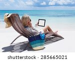 Woman Relaxing On The Beach An...