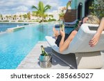 lady relaxing in deck chair by... | Shutterstock . vector #285665027
