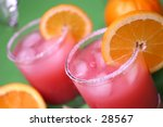 Close up of a mixed drink cocktail with orange wedge - stock photo