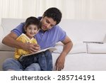 father helping his son in... | Shutterstock . vector #285714191