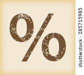 grungy brown icon with percent...