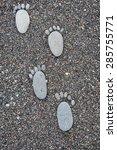 Footprint On Wet Sea Pebbles ...