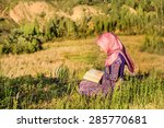 muslim woman reading holy quran ... | Shutterstock . vector #285770681
