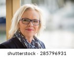 Small photo of Happy middle aged woman smiling.