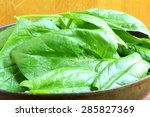 spinach leaves on wooden...   Shutterstock . vector #285827369