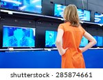 teenager girl looks at lcd tvs... | Shutterstock . vector #285874661