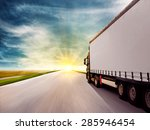 truck driving towards sunset | Shutterstock . vector #285946454