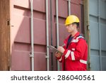male worker inspecting cargo... | Shutterstock . vector #286040561