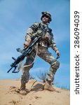 Small photo of United States paratrooper airborne infantry in the desert