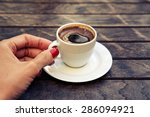 woman's hand holding a cup of... | Shutterstock . vector #286094921