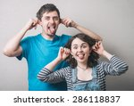 young couple is showing tongues ... | Shutterstock . vector #286118837