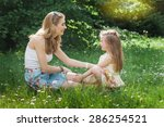mother and daughter sitting on... | Shutterstock . vector #286254521
